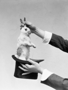 h-armstrong-roberts-hands-of-magician-performing-magic-trick-pulling-rabbit-out-of-top-hat